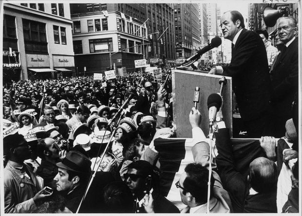 Louis Stulberg looks on as Hubert H. Humphrey gives a speech during his November 15, 1968 campaign